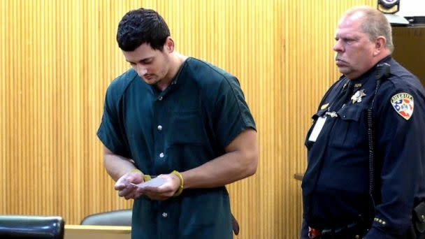 PHOTO: John Ozbilgen, ex-boyfriend of missing Stephanie Parze, reads a note as he leaves State Superior Court in Freehold, N.J., Nov. 19, 2019. (Asbury Park Press via USA Today Network, FILE)