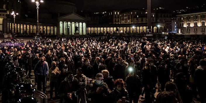 Citizens together with shopkeepers protest in Piazza Plebiscito against the anti-Covid restrictions imposed by the Italian Government of Giuseppe Conte and the Regional Council of Governor Vincenzo De Luca, to limit the spread of the Covid-19 virus, in Naples, Italy, on 26 October 2020. After the last Dpcm of Giuseppe Conte's Italian Government, which establishes the closure of various commercial activities (gyms, cinemas, theatres, amusement arcades, wellness centres) and the closure at 6pm for restaurants, pubs and coffebars, until November 24th, bringing a series of protests and disapproval in many Italian squares by citizens and traders due to the loss of job opportunities. (Photo by Manuel Dorati/NurPhoto via Getty Images)