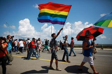 FILE PHOTO: Gay rights activists get together before the Annual March against Homophobia and Transphobia in Havana, May 14, 2016. REUTERS/Alexandre Meneghini
