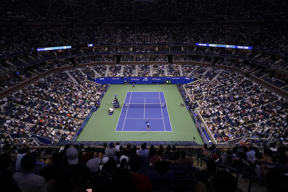 Novak Djokovic, foreground, of Serbia, serves to Matteo Berrettini, of Italy, during the quarterfinals of the U.S. Open tennis tournament at Arthur Ashe Stadium, Wednesday, Sept. 8, 2021, in New York. (AP Photo/Frank Franklin II)