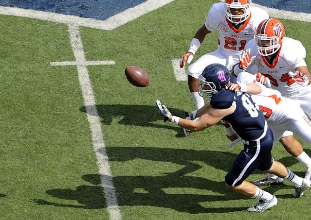 Rice wide receiver Andre Gautreaux (83) loses the ball under pressure from UTEP's Dashone Smith (21), Anthony Puente (34) and Wesley Miller (13) for an incomplete pass in the first half of an NCAA college football game Saturday, Oct. 26, 2013, in Houston. (AP Photo/Pat Sullivan)