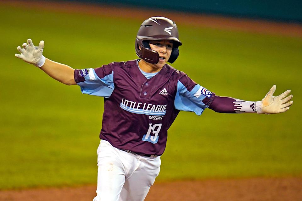 Little League baseball player wears C-Flap in game in South Williamsport, Pa., on Aug. 24, 2021.