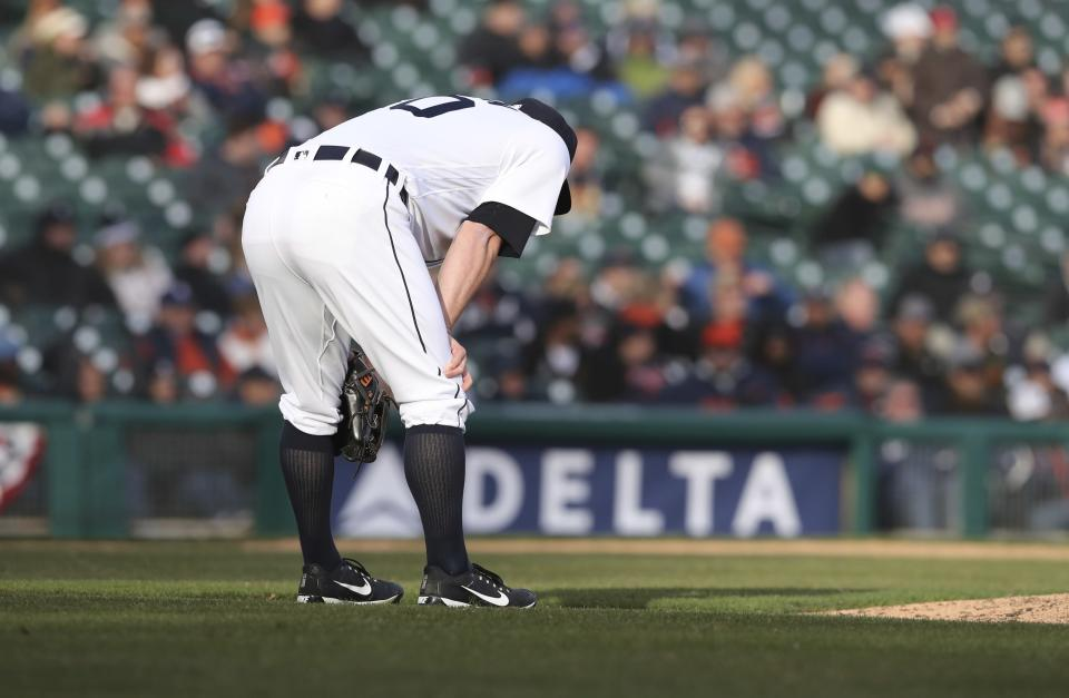 Detroit Tigers relief pitcher Alex Wilson reacts after giving up a three-run home run to Pittsburgh Pirates' Gregory Polanco during the 13th inning of a baseball game, Friday, March 30, 2018, in Detroit. (AP Photo/Carlos Osorio)