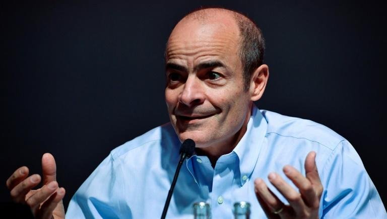 The share price for the beer giant behind Stella Artois and Budweiser, AB InBev, its CEO Carlos Brito pictured in a file image,  showed limited spillover from a shock decision tocall time on what would have been the year's largest stock sale