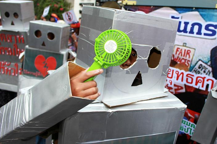 <p>Protesters attend a rally dressed up as robots during a march on International Workers' Day on May 1, 2017. Thai workers called for better-guaranteed labour rights on Monday as they participated in a rally organized by various labour unions in downtown Bangkok. (Vichan Poti/Pacific Press via ZUMA Wire) </p>