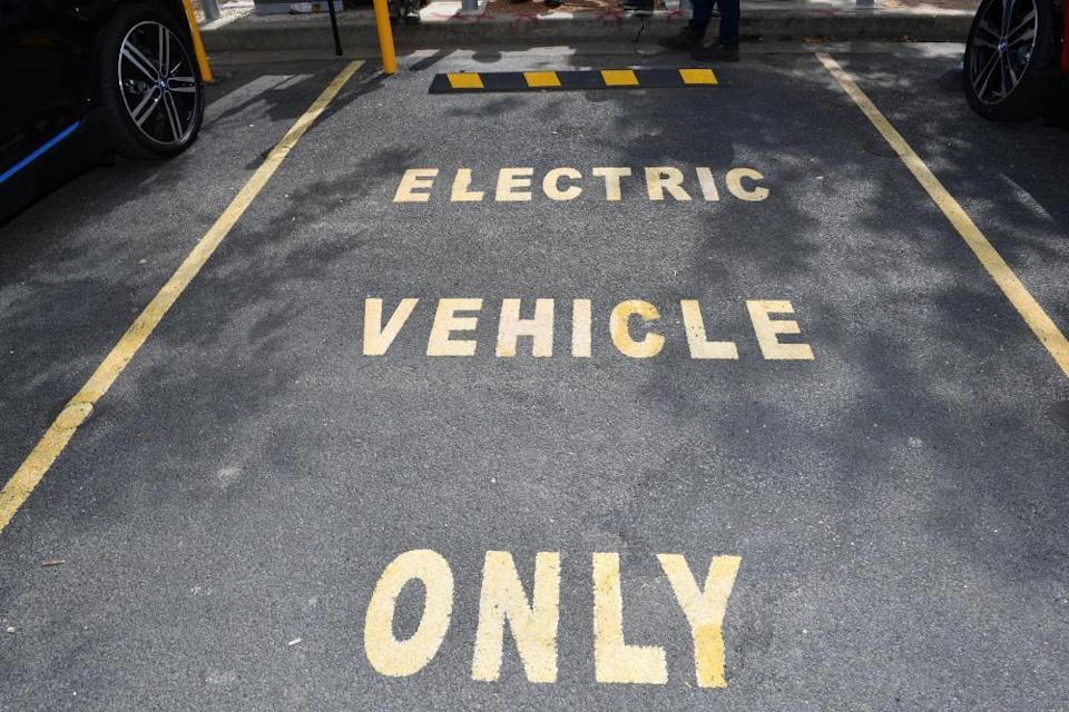 An empty car space reserved for electric vehicles