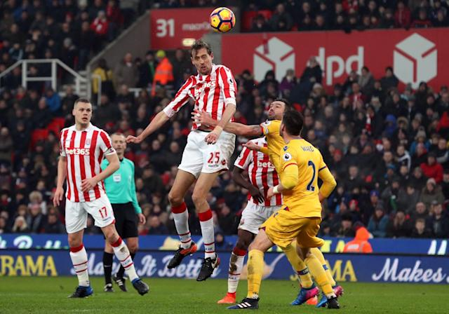 <p>Stoke City's Peter Crouch heads towards goal</p>