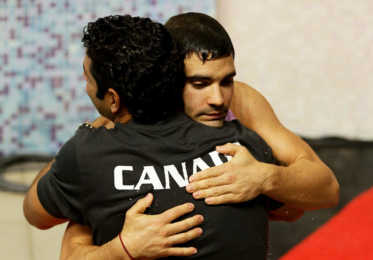 DELHI, INDIA - OCTOBER 11:  Alexandre Despatie of Canada celebrates a member of his coaching team after winning the gold medal in the Men's 3m Springboard Final at Dr. S.P. Mukherjee Aquatics Complex during day eight of the Delhi 2010 Commonwealth Games on October 11, 2010 in Delhi, India.  (Photo by Matt King/Getty Images)