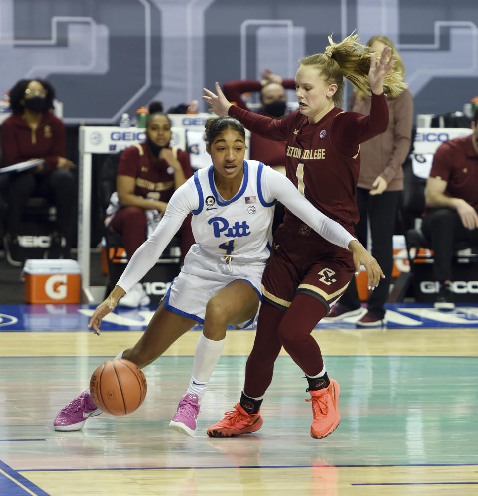 Pittsburgh's Emy Hayford drives the baseline under pressure from Boston College's Cameron Swartz in the opening round of the Atlantic Coast Conference Tournament, Wednesday, March 3, 2021, at the Greensboro Coliseum in Greensboro, N.C. (Walt Unks/The Winston-Salem Journal via AP)