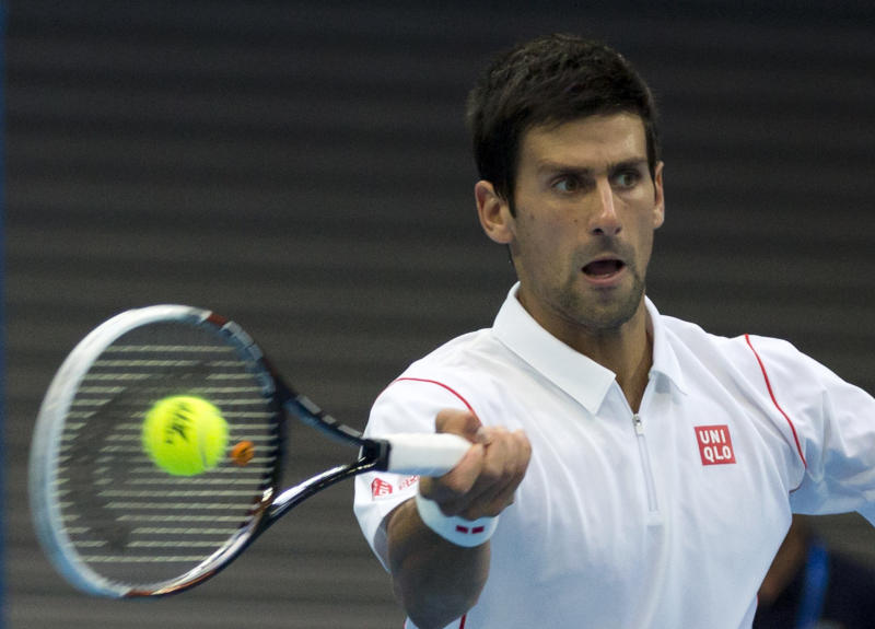 Novak Djokovic of Serbia returns a shot to Lukas Rosol of the Czech Republic during the China Open tennis tournament at the National Tennis Stadium in Beijing, China Tuesday, Oct. 1, 2013. (AP Photo/Andy Wong)