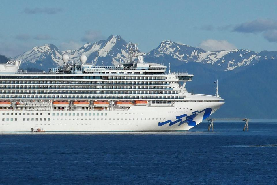 In this May 30, 2018, file photo, is the Grand Princess cruise ship in Gastineau Channel in Juneau, Alaska. The Canadian government has extended a ban on cruise ships through February 2022, which is expected to block trips from visiting Alaska this year. Transport Canada announced the extension of the ban put in place because of the COVID-19 pandemic.