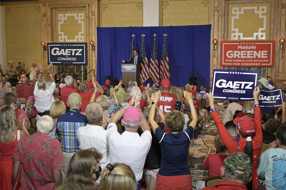 Rep. Matt Gaetz, R-Fla., addresses attendees of a rally featuring himself and Rep. Marjorie Taylor Greene, R-Ga., Friday, May 7, 2021, in The Villages, Fla. (AP Photo/Phelan M. Ebenhack)