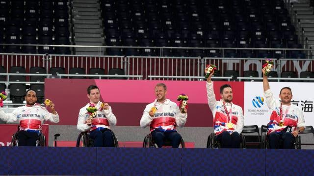 Britain's wheelchair rugby players celebrate with their gold medal during the awarding ceremony