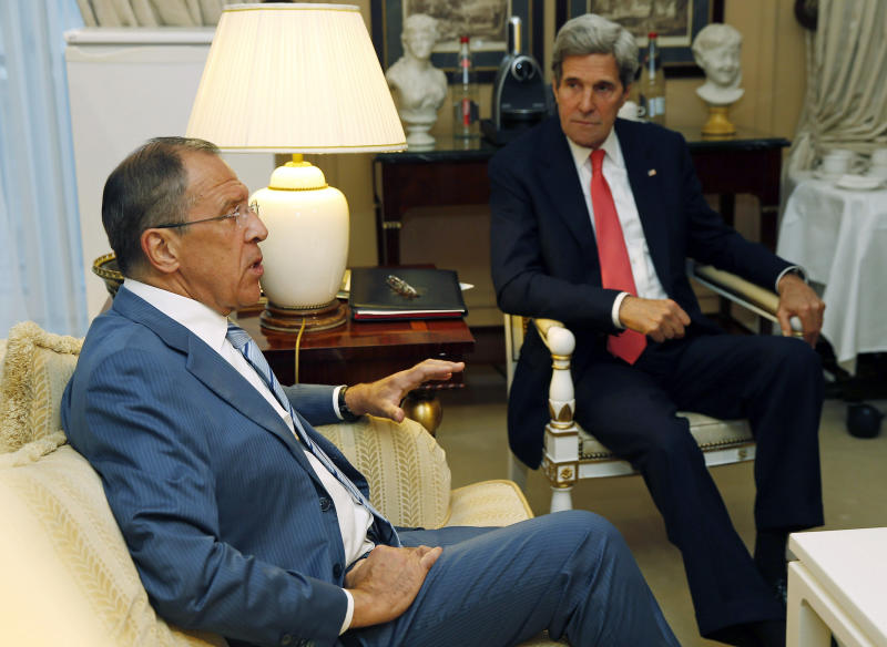 U.S. Secretary of State John Kerry, right, meets with Russian Foreign Minister Sergei Lavrov, Monday, May 27, 2013, in Paris. (AP Photo/Jim Young, Pool)