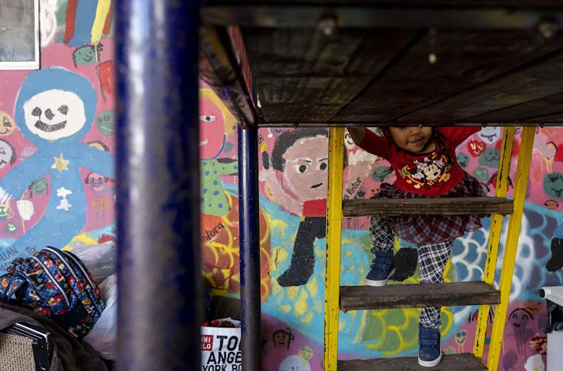 A child plays at one of the shelters in Tijuana, Mexico, February 2019, where migrants wait to meet with U.S. immigration officials and claim asylum in the United States.
