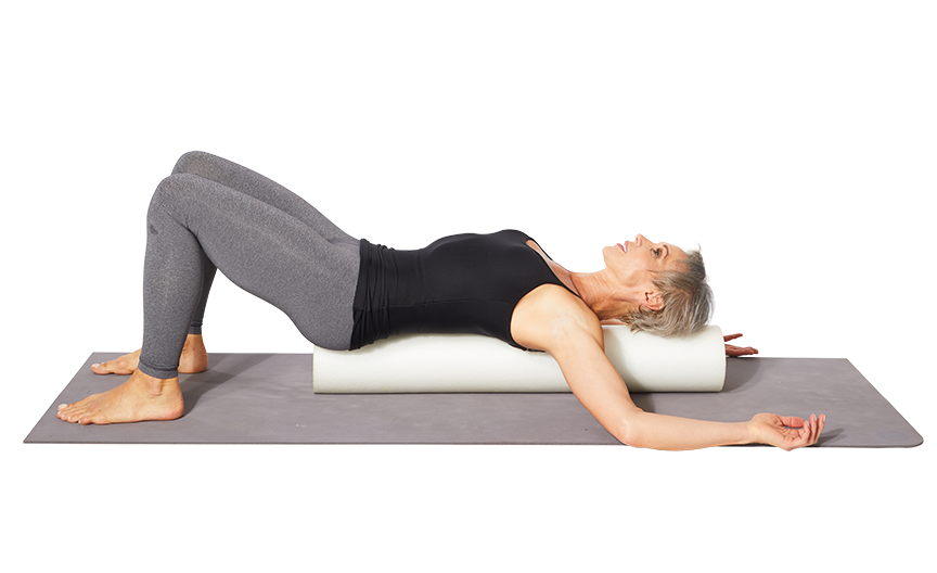 """<p><strong>This move releases pec muscles and elongates the spine to help with shoulder and back alignment.</strong></p><ol><li>Lying down on the mat, keep your knees bents and feet flat on the ground and lie a <a href=""""https://www.prevention.com/fitness/workout-clothes-gear/g28074559/best-foam-rollers/"""" rel=""""nofollow noopener"""" target=""""_blank"""" data-ylk=""""slk:foam roller"""" class=""""link rapid-noclick-resp"""">foam roller</a> so the roller lines up with the back of your head down to your tailbone.</li><li>Bring your palms together in front of your chest. Slowly open your arms out to the side like the letter """"T"""" allowing your hands to fall to the ground. (Let gravity and breathwork help increase the stretch.)</li><li>Hold for 3- seconds, then repeat 3 times.</li></ol>"""