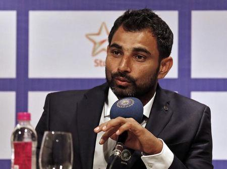 Indian cricketer Shami speaks during a news conference in Mumbai
