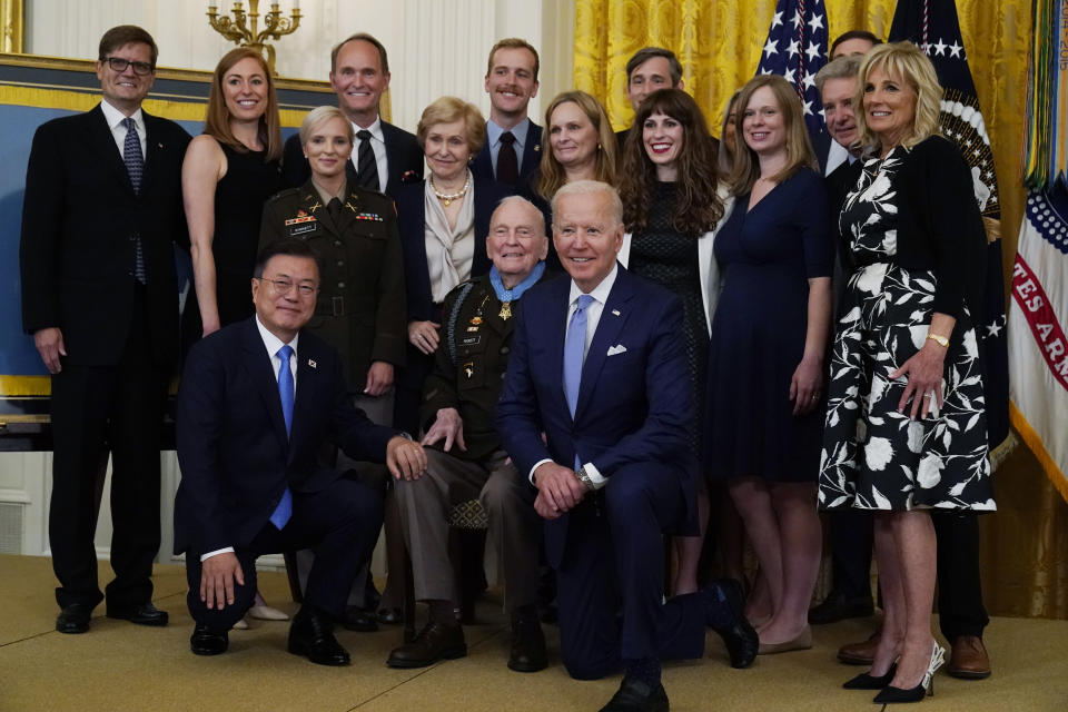 President Joe Biden, retired U.S. Army Col. Ralph Puckett and South Korean President Moon Jae-in, pose for a photo after Puckett was presented the Medal of Honor in the East Room of the White House, Friday, May 21, 2021, in Washington. First lady Jill Biden is right. (AP Photo/Alex Brandon)