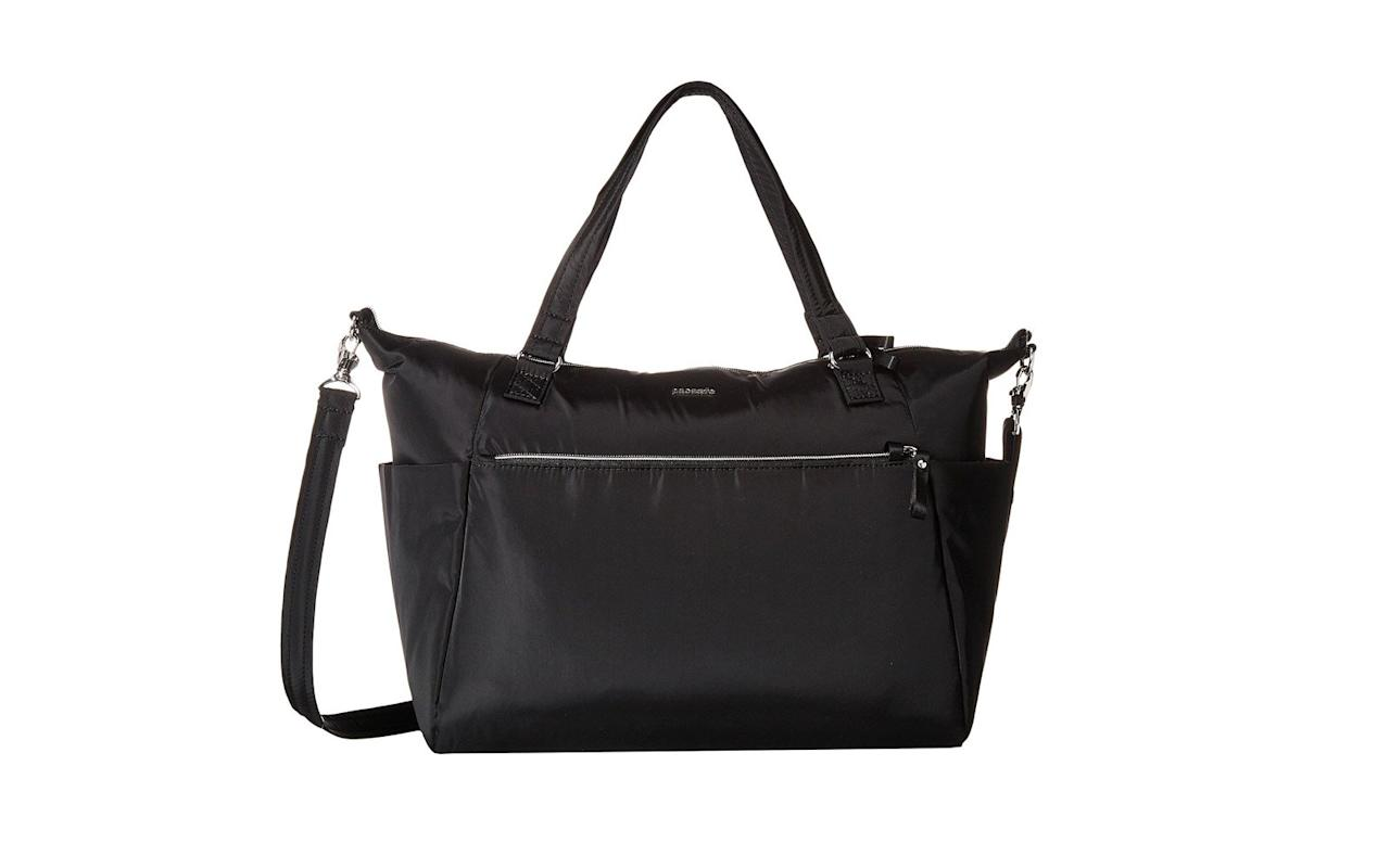 """<p>This roomy and lightweight tote is perfect for the traveler who tends to carry (or shop) a lot. It has a secure zip closure that locks to the zip clip and plenty of pockets for everything from an umbrella to your keys.</p> <p>To buy: <a href=""""http://www.anrdoezrs.net/links/7876402/type/dlg/sid/TL%2C15Anti-theftTravelBagsThatWillProtectYourStuffinStyle%2Cchenk%2CTRA%2CGAL%2C591413%2C201907%2CI/https://www.zappos.com/p/pacsafe-stylesafe-anti-theft-tote-navy/product/9034227/color/9"""" target=""""_blank"""">zappos.com</a>, $110</p>"""