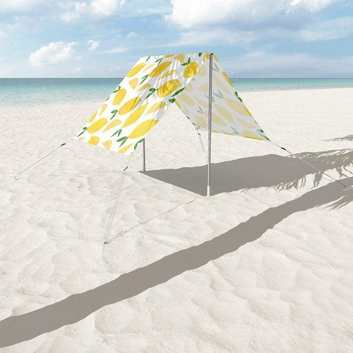 """<br> <br> <strong>Lathe & Quill</strong> Lemon Cut Out Pattern Sun Shade, $, available at <a href=""""https://go.skimresources.com/?id=30283X879131&url=https%3A%2F%2Fsociety6.com%2Fproduct%2Flemon-cut-out-pattern_sun-shade"""" rel=""""nofollow noopener"""" target=""""_blank"""" data-ylk=""""slk:Society6"""" class=""""link rapid-noclick-resp"""">Society6</a>"""