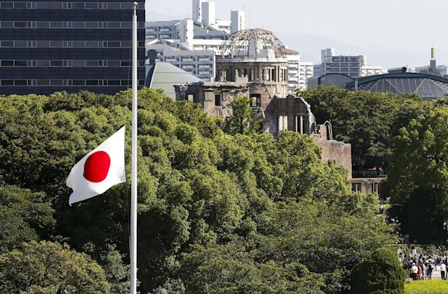 <p>A Japanese national flag flies at half-mast during the memorial ceremony for victims of the Aug. 6,1945 atomic bombing at the Hiroshima Peace Memorial Park in Hiroshima, Japan, Aug. 6, 2017. (Photo: Kimimasa Mayama/EPA/REX/Shutterstock) </p>