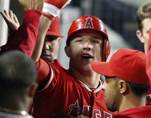 The Los Angeles Angels' Mike Trout and teammates celebrate his solo home run against the Los Angeles Dodgers in the fourth inning of an interleague baseball game at Dodger Stadium in Los Angeles Monday, June 11, 2012. (AP Photo/Reed Saxon)