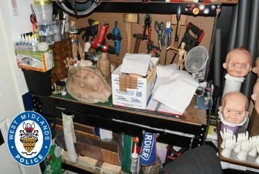 A workbench, tools and doll's heads found at the home of Nathan Maynard-Ellis in Tipton. (PA/West Midlands Police)