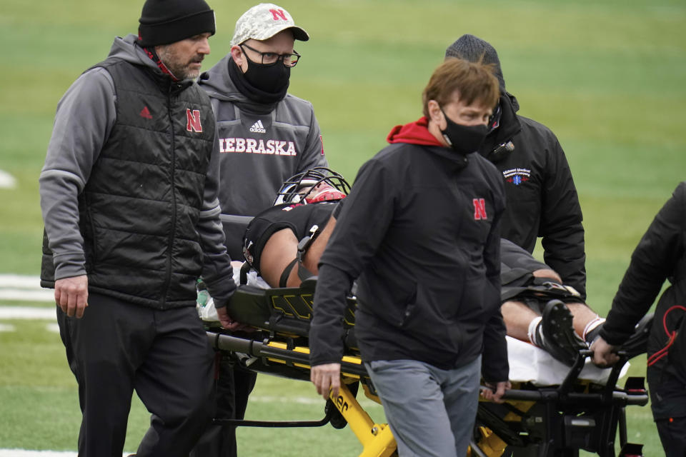 Nebraska linebacker Collin Miller is taken off the field on a stretcher during the second half of an NCAA college football game against Illinois in Lincoln, Neb., Saturday, Nov. 21, 2020. He appeared to have been hurt while tackling Illinois' Mike Epstein. Illinois won 41-23. (AP Photo/Nati Harnik)