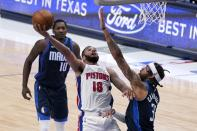 Detroit Pistons guard Cory Joseph (18) shoots as Dallas Mavericks' Dorian Finney-Smith (10) and Willie Cauley-Stein defend during the second half of an NBA basketball game in Dallas, Wednesday, April 21, 2021. (AP Photo/Tony Gutierrez)