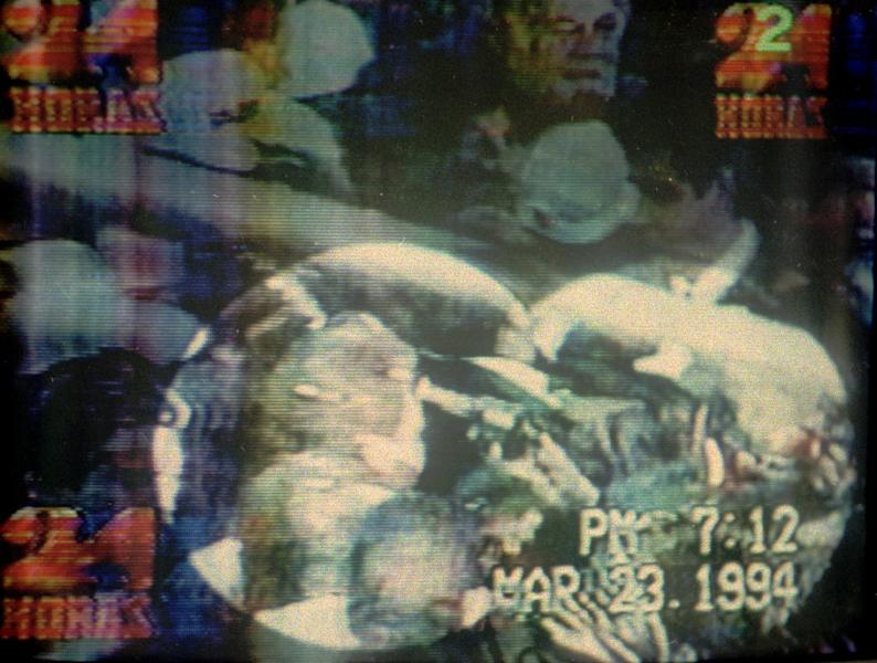 """FILE - This March 23, 1994 television image shows Mexico's leading presidential candidate Luis Donaldo Colosio as he is shot in the head. The film """"Colosio,"""" directed by Mexican Carlos Bolado, portrays the 1994 killing of the candidate who was almost certain to be the next president, casts doubts on the official conclusion that a lone gunman planned and carried out the killing of Colosio, which is often compared to John F. Kennedy's assassination. It is one of several new politically minded films being released just ahead of Mexico's July 1 election that are aimed at reminding Mexicans of the dark side of the Institutional Revolutionary Party, which governed Mexico for 71 years, and which seems set to return to power. (AP Photo/Televisa, File)"""