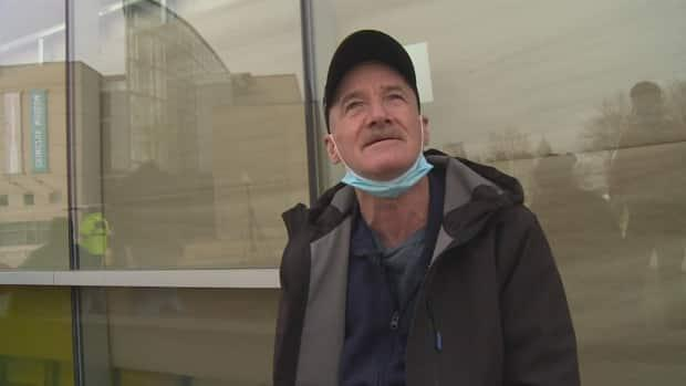 Kevin Keane says he was turned away from entering the city's emergency shelter at the Windsor International Training and Aquatic Centre. He went to the aquatic centre Wednesday with several others to get tested and possibly be offered shelter. (Jacob Barker/CBC - image credit)