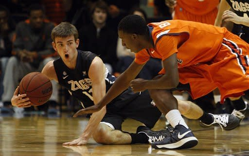 Gonzaga guard David Stockton (11) and Pepperdine guard Jordan Baker (1) scramble on the floor in the first half of an NCAA college basketball game at Pepperdine in Malibu, Calif., Thursday, Jan. 3, 2013. (AP Photo/Reed Saxon)