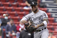 Chicago White Sox's Yoan Moncada throws to first in the third inning of a baseball game, Sunday, April 18, 2021, in Boston. (AP Photo/Steven Senne)