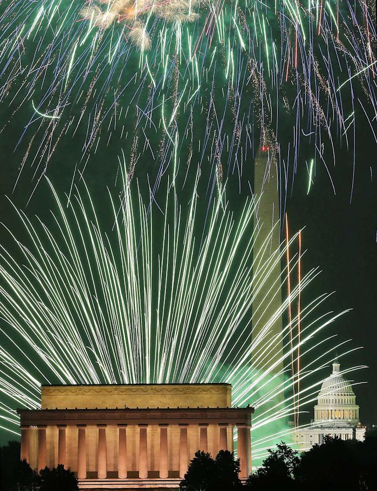 WASHINGTON, DC - JULY 04: (EDITORS NOTE: Retransmission with alternate crop.) Fireworks light up the sky over the Lincoln Memorial, Washington Monument, and the U.S. Capitol on July 4, 2012 in Washington, DC. July 4th is a national holiday with the nation celebrating its 237th birthday. (Photo by Mark Wilson/Getty Images)