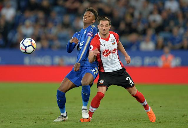"""Soccer Football - Premier League - Leicester City vs Southampton - King Power Stadium, Leicester, Britain - April 19, 2018 Southampton's Cedric Soares in action with Leicester City's Demarai Gray REUTERS/Peter Powell EDITORIAL USE ONLY. No use with unauthorized audio, video, data, fixture lists, club/league logos or """"live"""" services. Online in-match use limited to 75 images, no video emulation. No use in betting, games or single club/league/player publications. Please contact your account representative for further details."""