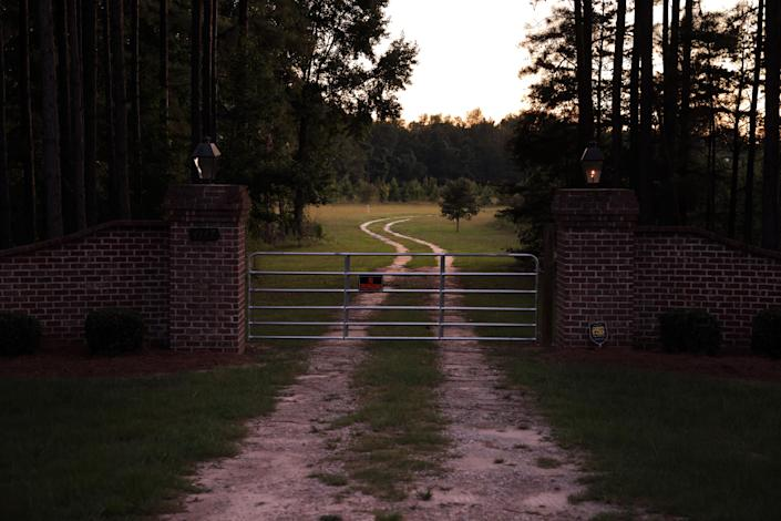 An entrance gate to the estate in Islandton, S.C., where Alex Murdaugh's wife and son were found shot to death. (Travis Dove/The New York Times)
