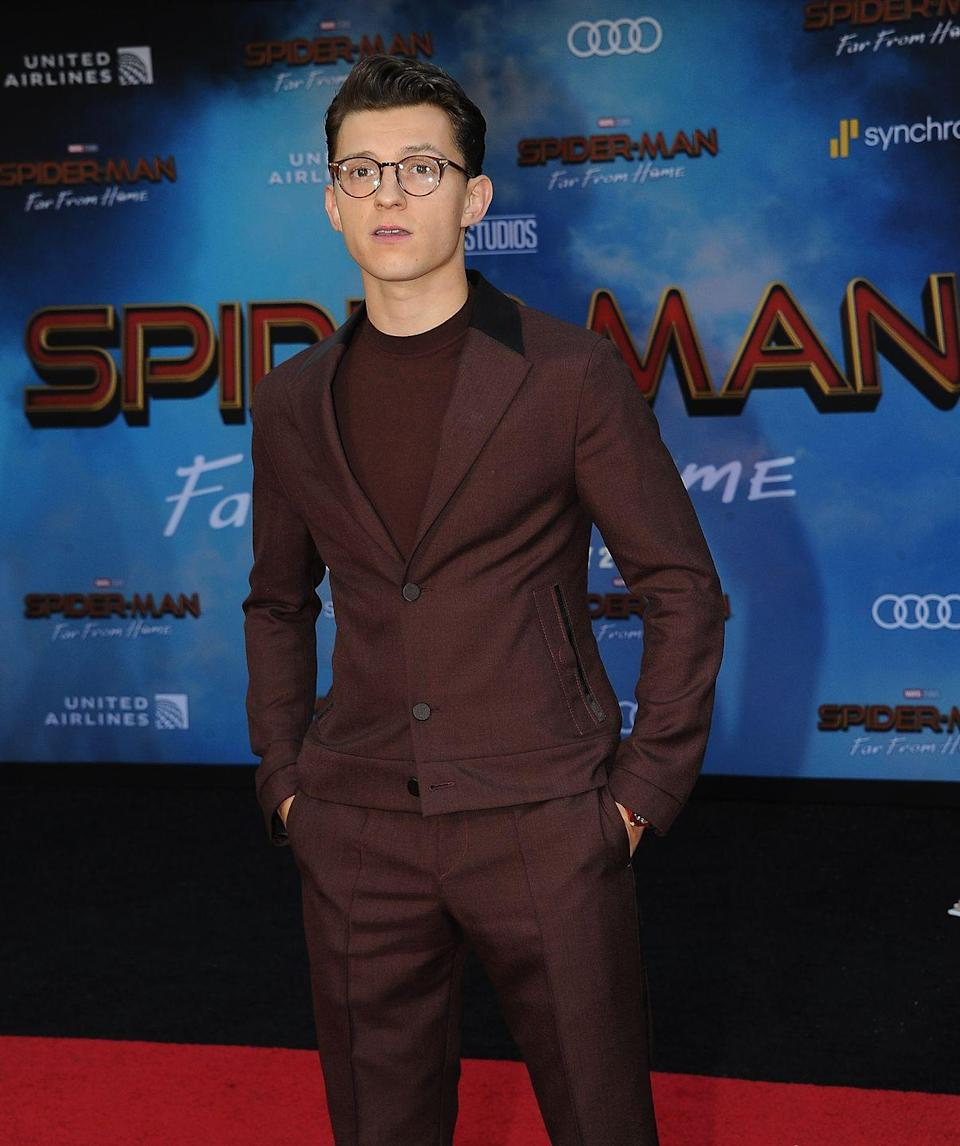 """<p>The <a href=""""https://www.menshealth.com/entertainment/g28195938/spider-man-actors-list/"""" rel=""""nofollow noopener"""" target=""""_blank"""" data-ylk=""""slk:latest Spider-Man"""" class=""""link rapid-noclick-resp"""">latest Spider-Man</a> knows how good he looks with his suit and glasses.</p>"""