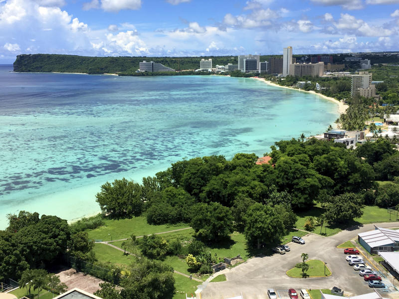 FILE -- This Aug. 14, 2017 file photo shows Tumon Bay near Hagåtña, Guam. The 1941 Japanese invasion of Guam, which happened on the same December day as the attack on Hawaii's Pearl Harbor, set off years of forced labor, internment, torture, rape and beheadings.   Now, more than 75 years later, thousands of people on Guam, a U.S. territory, are expecting to get long-awaited compensation for their suffering at the hands of imperial Japan during World War II. (AP Photo/Tassanee Vejpongsa, File)