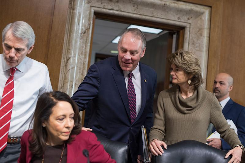 Interior Secretary Ryan Zinke, center, arrives to testify at a Senate Energy and Natural Resources Committee hearing on Tuesday. Also pictured are Chairwoman Lisa Murkowski (R-Alaska) (right), Sen. Maria Cantwell (D-Wash.) and Sen. Rob Portman (R-Ohio) (left). (Photo: Tom Williams via Getty Images)