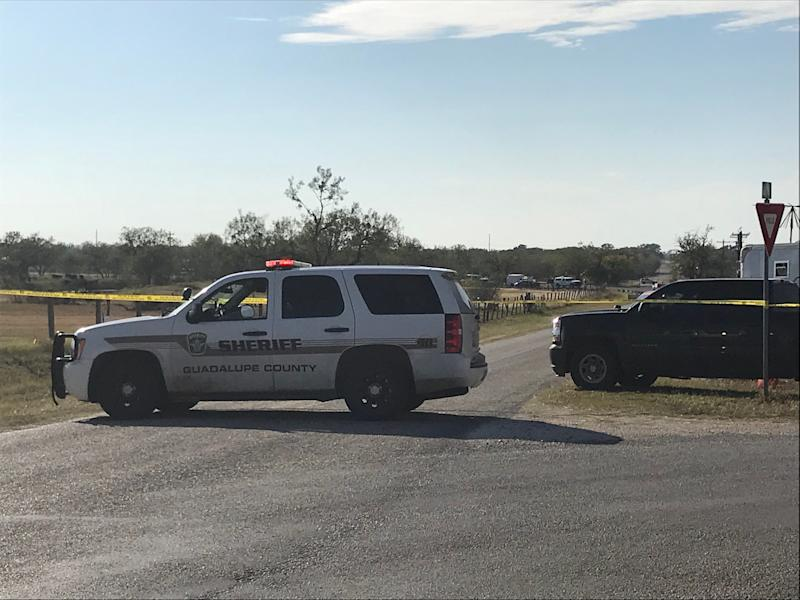 Police block a road in Sutherland Springs, Texas, after a gunman shot dozens of people at a nearby church on Sunday. Sutherland Springs is located about 35 miles east of San Antonio.
