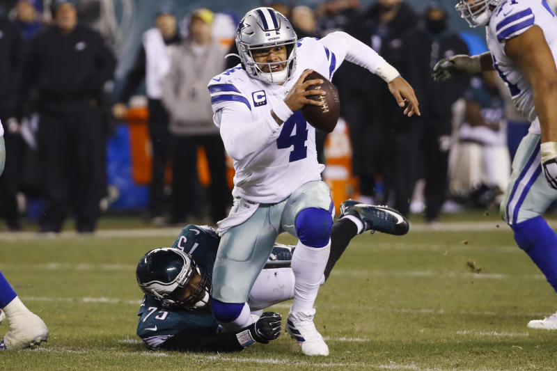 Philadelphia Eagles' Vinny Curry (75) pulls down Dallas Cowboys quarterback Dak Prescott (4) during the second half of an NFL football game Sunday, Dec. 22, 2019, in Philadelphia. (AP Photo/Chris Szagola)