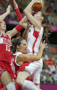 Canada guard Kim Smith, top, collides with Russia guard Becky Hammon on a drive to the basket during a basketball game at the 2012 Summer Olympics, Saturday, July 28, 2012, in London. (AP Photo/Charles Krupa)
