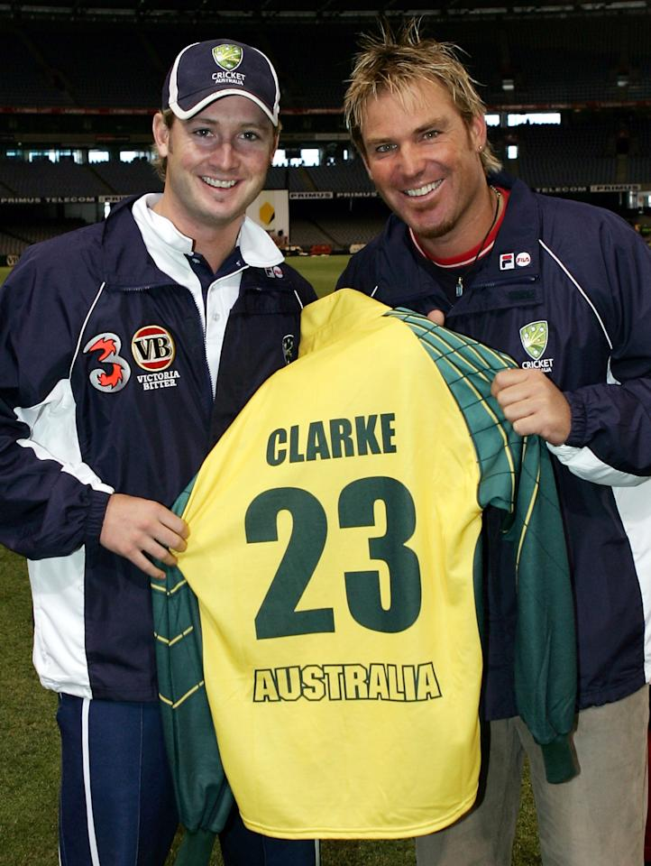 MELBOURNE, AUSTRALIA - DECEMBER 4:  Shane Warne of Australia (R) presents his former number 23 to team mate Michael Clarke after his retirement from one-day cricket after training at Telstra Dome on December 4, 2004 in Melbourne, Australia.  (Photo by Hamish Blair/Getty Images)