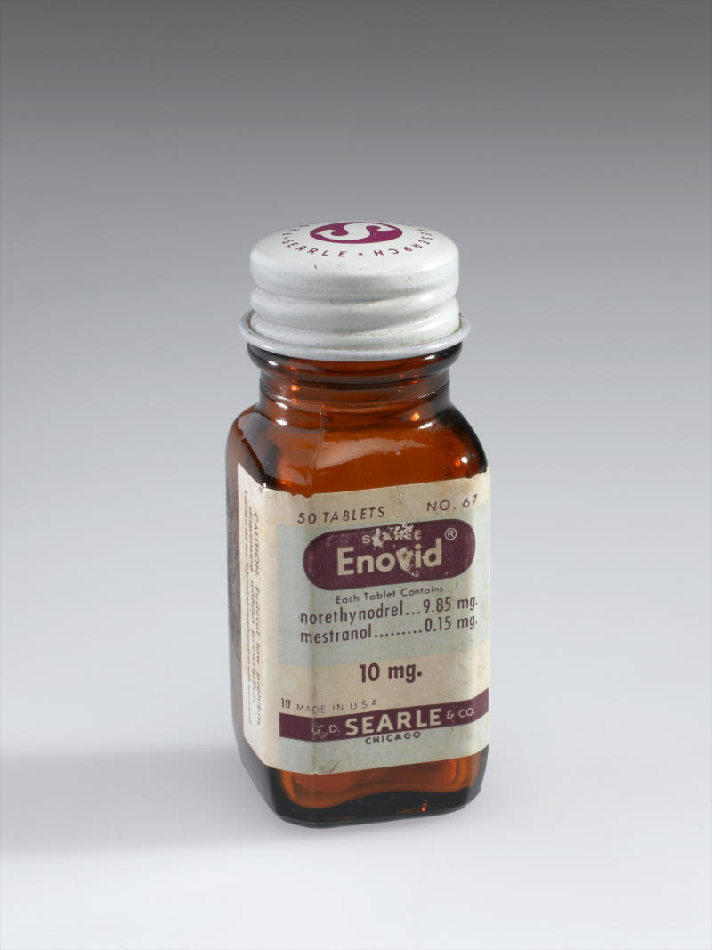 UNITED KINGDOM - JANUARY 25: Bottle of Enovid tabs 10mg, early 1960s. Front three quarter view. Graduated grey background. (Photo by Science Museum/SSPL/Getty Images)