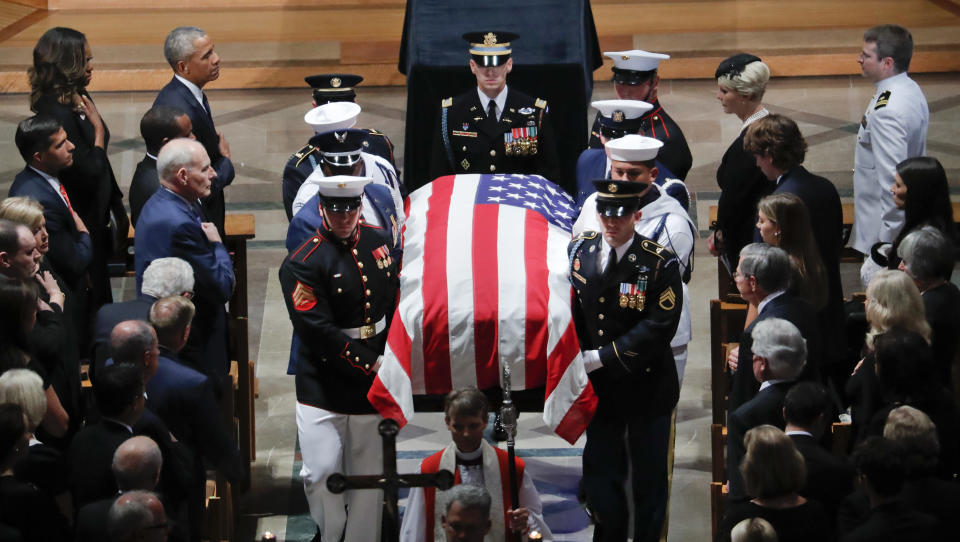 The family of Sen. John McCain, R-Ariz., follows as his casket is carried during the recessional at the end of a memorial service at Washington National Cathedral in Washington, Saturday, Sept. 1, 2018. McCain died Aug. 25, from brain cancer at age 81. (AP Photo/Pablo Martinez Monsivais)
