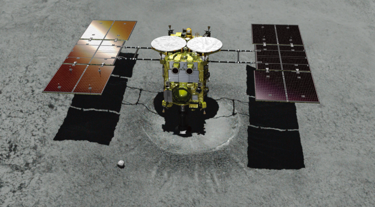 <em>This computer graphics image shows asteroid explorer Hayabusa2 landing on a crater that it made (PA)</em>