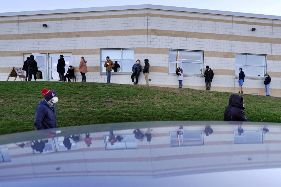 Voters wait to cast their ballots in the general election outside the East End Elementary School, Tuesday, Nov. 3, 2020, in Portland, Maine.(AP Photo/Robert F. Bukaty)