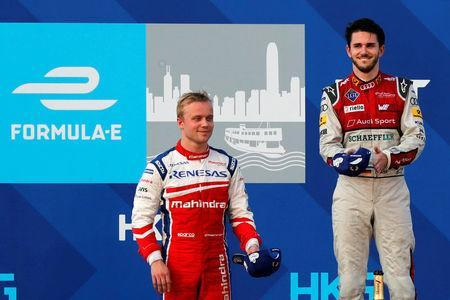 Formula E - FIA Formula E Hong Kong ePrix - Hong Kong - December 3, 2017 Mahindra's Felix Rosenqvist of Sweden and ABT Schaeffler Audi Sport's Daniel Abt of Germany react after the race. REUTERS/Tyrone Siu
