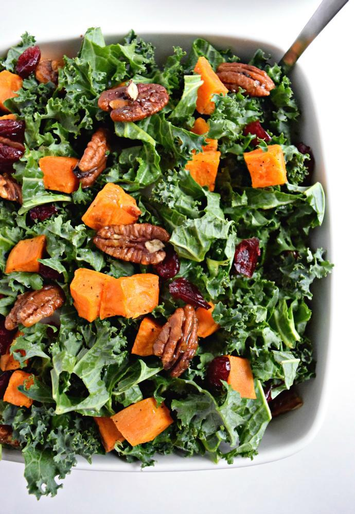 "<p>Keep things very healthy for your Thanksgiving meal by combining your side salad and sweet potato dish. This recipe requires minimal work and time but gives you the familiar spiced, roasted potato and pecan paired with a healthy kale-and-cranberry salad. <br><br><a href="" http://isabeleats.com/roasted-sweet-potato-kale-salad-with-candied-pecans-cranberries/"" rel=""nofollow noopener"" target=""_blank"" data-ylk=""slk:Get the recipe"" class=""link rapid-noclick-resp"">Get the recipe</a> </p>"