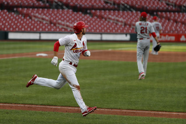 St. Louis Cardinals' Paul DeJong, left, rounds the bases after hitting a two-run home run off pitcher Andrew Miller (21) during an intrasquad practice baseball game at Busch Stadium Thursday, July 9, 2020, in St. Louis. (AP Photo/Jeff Roberson)